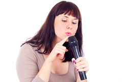 Beautiful girl checks the microphone Royalty Free Stock Image