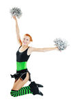 Beautiful girl cheerleader. Uniformed cheerleader jumps high in the air isolated on white Royalty Free Stock Photography