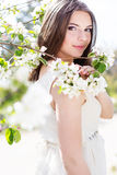 Beautiful girl in a cherry blossom garden Royalty Free Stock Image
