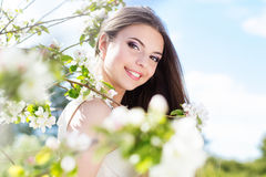 Beautiful girl in a cherry blossom garden Royalty Free Stock Photo
