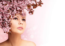 Beautiful Girl With Cherry Blossom isolated on white. Beauty Stock Photography