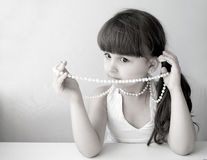 Beautiful girl child with pearl bead Stock Photo
