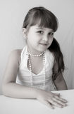 Beautiful girl child with pearl bead Royalty Free Stock Photo