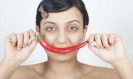 Beautiful girl with chili Royalty Free Stock Images