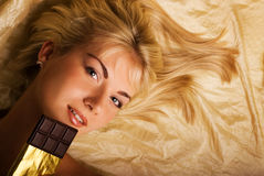 Beautiful girl with a chocolate Royalty Free Stock Image