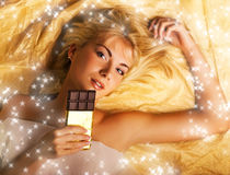 Beautiful girl with a chocolate Royalty Free Stock Photography