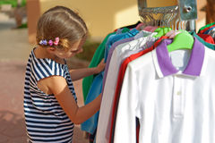 Beautiful girl choose right clothes Stock Image
