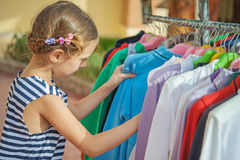 Beautiful girl choose right clothes Royalty Free Stock Photo