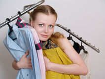 The beautiful girl chooses clothes in shop Royalty Free Stock Photo