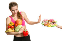 Beautiful girl chooses fruit and vegetables Royalty Free Stock Photography