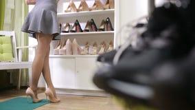 Beautiful girl choosing a pair of high heels shoes. Beautiful legs. stock footage