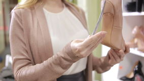 Beautiful girl choosing a pair of high heels shoes. Beautiful legs. stock video