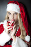 Beautiful girl with christmas clothes. Stock Images