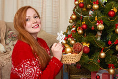 Beautiful girl in christmas decoration. Home interior with decorated fir tree and gifts. New year eve and winter holiday concept. Royalty Free Stock Photo