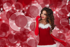 Beautiful girl in christmas dress. woman looking to the left of the frame towards blank copy space. Royalty Free Stock Images