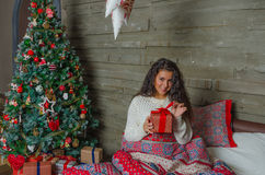 Beautiful girl, Christmas eve, alone. Stock Image