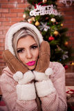 Beautiful girl on Christmas eve. With a pink lipstick stock photography