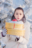 Beautiful girl with christmas gift  outdoor Royalty Free Stock Photos