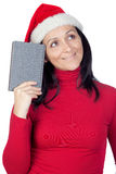 Beautiful girl with Christmas hat and a book Stock Photography