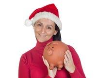 Beautiful girl with Christmas hat saving Stock Photo