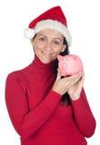 Beautiful girl with Christmas hat saving Stock Photography