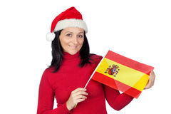 Beautiful girl with Christmas hat and spanish flag Stock Photography