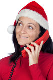 Beautiful girl with Christmas hat to phone Stock Photo
