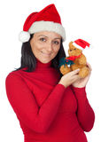 Beautiful girl with a Christmas teddy bear Stock Images