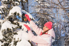 Beautiful girl with christmas toy  outdoor Stock Image
