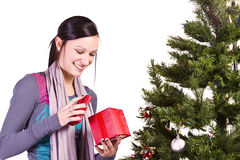 Beautiful Girl by the Christmas Tree Stock Photo