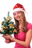 Beautiful girl with Christmas tree. Royalty Free Stock Photos