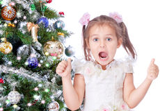 Beautiful girl with a Christmas tree stock image