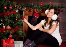 Beautiful girl with a Christmas tree Royalty Free Stock Photos