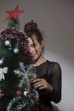 Beautiful girl and Christmas tree Stock Photography