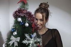 Beautiful girl and Christmas tree Royalty Free Stock Photos