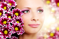 Beautiful girl with chrysanthemum Royalty Free Stock Photos