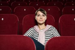 Beautiful girl at the cinema Royalty Free Stock Image