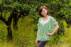 Beautiful girl in citrus orchard. A chinese girl who wearing a green shirt in citrus orchard stock image