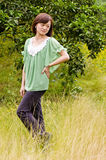 Beautiful girl in citrus orchard. A chinese girl who wearing a green shirt in citrus orchard stock photos