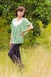 Beautiful girl in citrus orchard Stock Photos