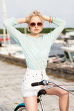 Beautiful girl with city bike at sea pier Stock Photography
