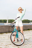 Beautiful girl with city bike at sea pier Stock Images