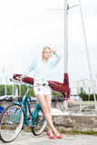 Beautiful girl with city bike at sea pier Royalty Free Stock Images