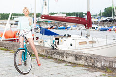 Beautiful girl with city bike at sea pier Royalty Free Stock Photos