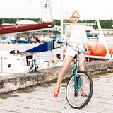 Beautiful girl with city bike at sea pier Royalty Free Stock Image