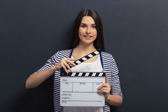 Beautiful girl with clapperboard Royalty Free Stock Photography