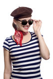 Beautiful girl in classic 60s french look. Beautiful girl with red bandana, beret and striped shirt in a classic 60s french look stock photos