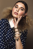 Beautiful girl with classic make-up and hairstyle art, clothing retro style. Beauty face stock photography