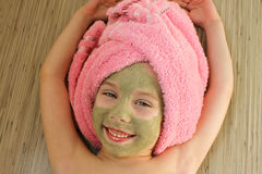 Beautiful girl with clay mask facial.  Stock Image