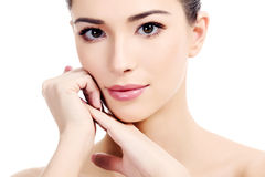 Beautiful girl with clean fresh skin. White background, copyspace stock photos